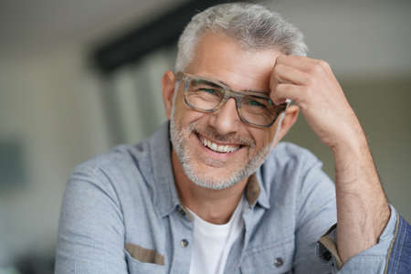 Middle-aged guy with trendy eyeglasses Archivio Fotografico