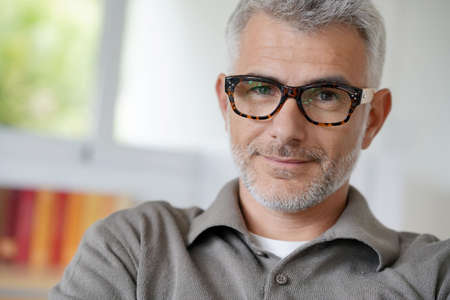 Portrait of smiling middle-aged man with eyeglasses