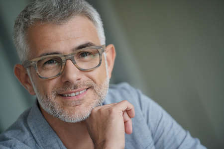 Middle-aged guy with trendy eyeglasses Stock Photo