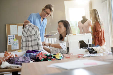 Fashion designers in office designing new garment Stock Photo