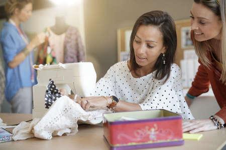 Fashion designer using sewing machine