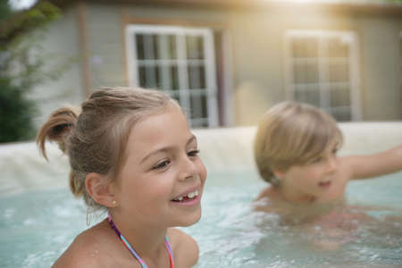 Portrait of kids enjoying hot jacuzzi water