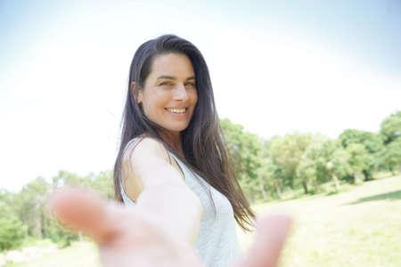 Portrait of smiling beautiful brunette woman Stock Photo