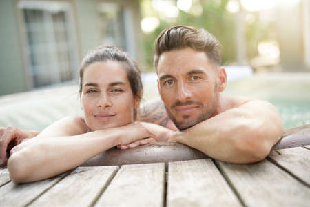Couple enjoying relaxing time in jacuzzi Reklamní fotografie