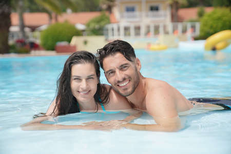 Portrait of middle-aged couple at the swimming-pool