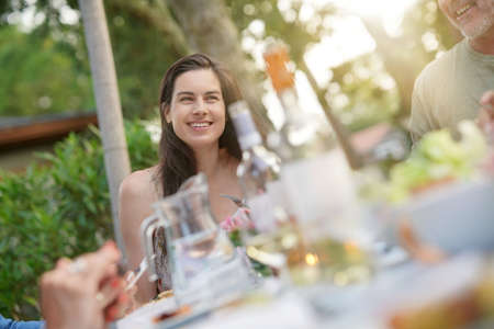 Cheerful woman at barbecue party