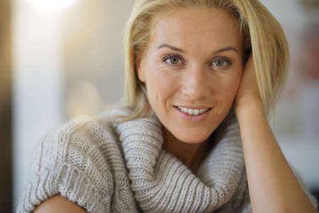 Portrait of 40-year-old woman with woolen sweater