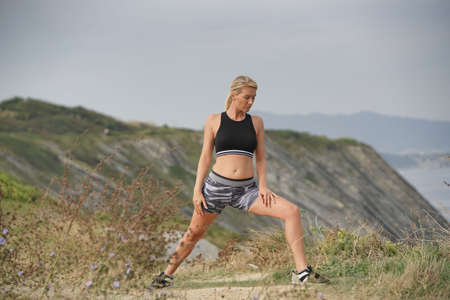 Woman doing outdoor fitness exercises