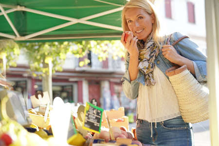 Middle-aged woman at the green market Reklamní fotografie