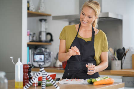 Woman cooking for culinary blog