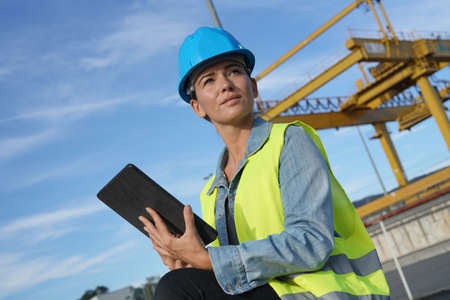Woman on a building site making sure everything is going well