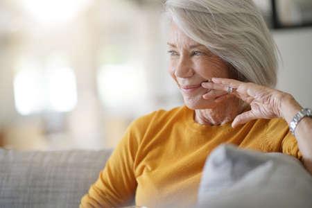 Beautiful senior woman relaxing at home