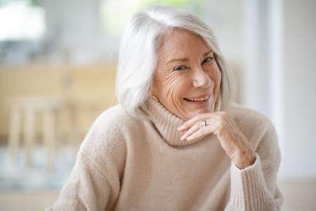 Happy senior woman sitting at home 版權商用圖片