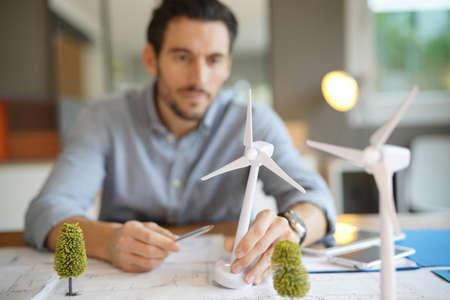 Handsome wind turbine engineer working in modern office Imagens - 113989060