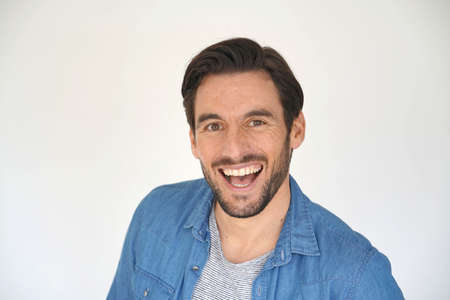 Portrait of casual laughing handsome man on white background