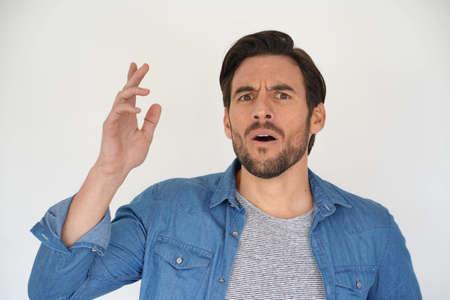 Expressive portrait of handsome man on white background