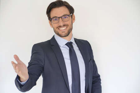 Isolated attractive businessman in suit extending arm out Reklamní fotografie