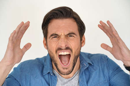 Portrait of handsome man shouting on white background