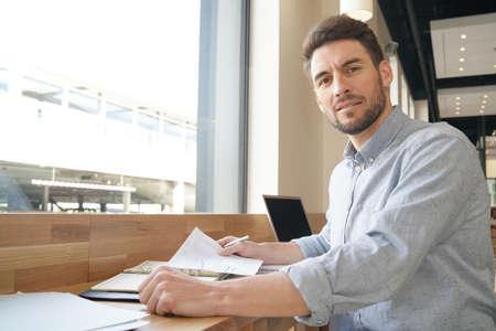 Handsome salesman preparing presentation on work trip Stock Photo - 119270516