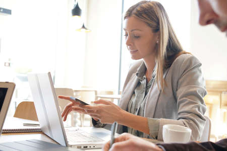 Saleswoman preparing sales pitch on work trip
