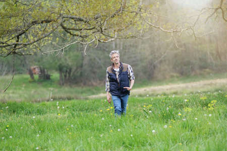 Mature man walking in countryside