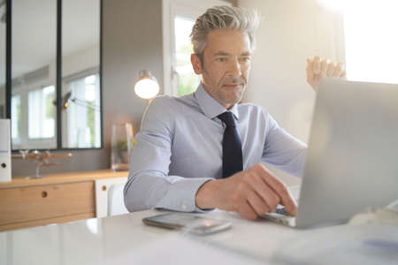 Handsome businessman working in contemporary office