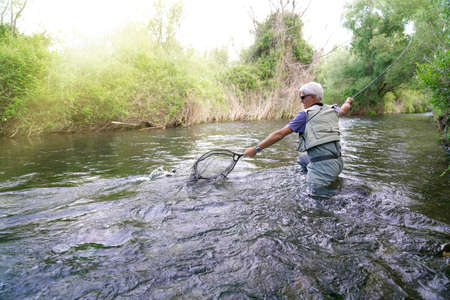 fly fisherman in the river Foto de archivo - 124705068