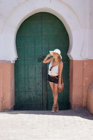 Portrait of beautiful girl visiting Marrakech, wearing sun hat Standard-Bild