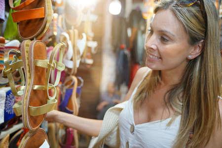 Tourist girl shopping in Moroccan souk of Marrakech Stock Photo