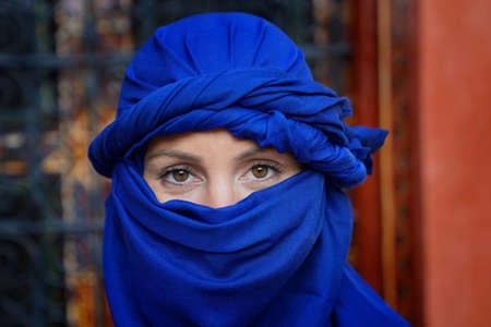 Portrait of woman wearing blue tuareg scarf
