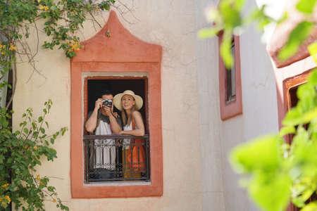 Couple looking out window in Moroccan riad Banco de Imagens