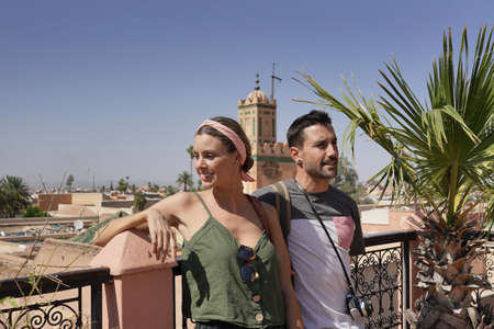 Couple looking out from rooftop in Marrakech Banco de Imagens