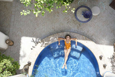 Stunning woman in beautiful moroccan pool
