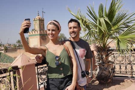 Couple taking selfie from rooftop in Marrakech Banco de Imagens