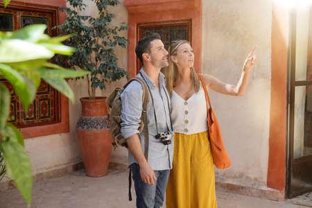 Stylish couple exploring traditional Moroccan riad Banco de Imagens