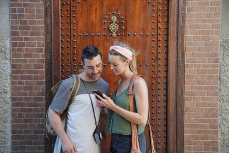 Couple checking cellphone in Morocco