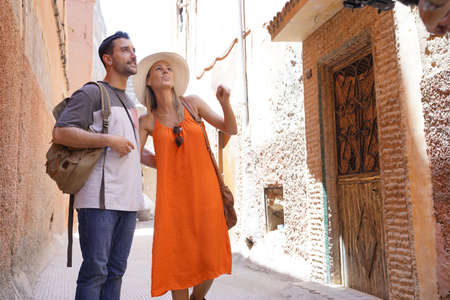 Attractive couple walking through streets in Marrakech