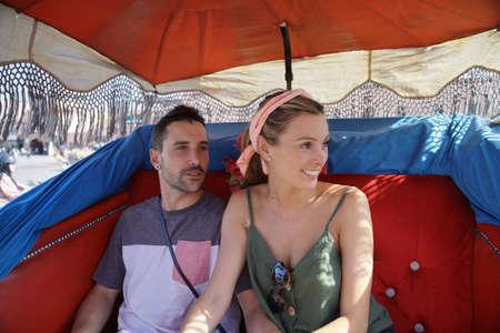 Couple enjoying horse drawn carriage ride in Marrakech