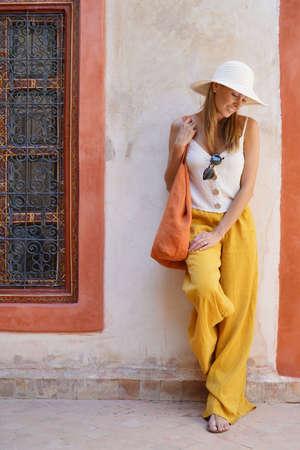 Elegant stylish woman smiling in Moroccan riad