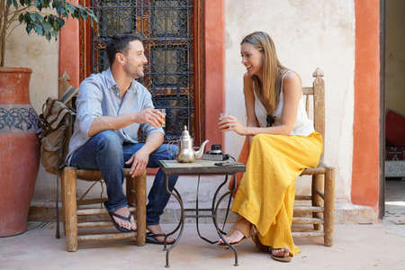 Couple sharing mint tea in morcoccan riad