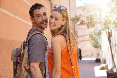 Couple smiling at camera in moroccan street