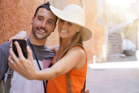 Couple taking selfie in side street in Marrakech