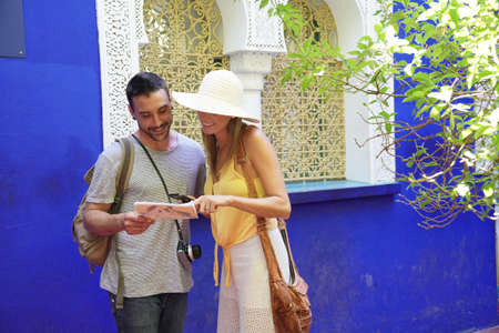 Couple looking at map in Majorelle Gardens in Morocco