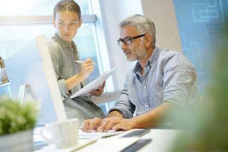 Informal coworkers working in contemporary office
