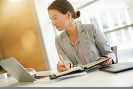 Young businesswoman working in contemporary office