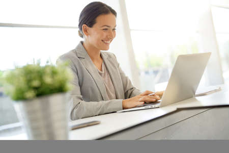 Smart businesswoman working in contemporary office