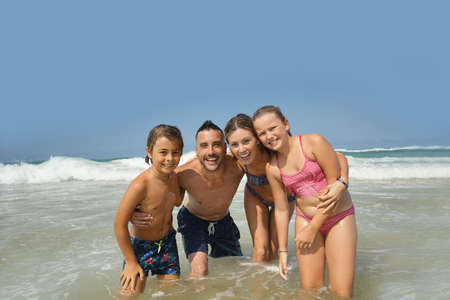 Family having fun in the waves