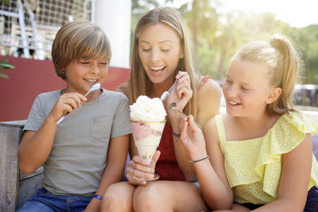 Mother and kids eating ice cream