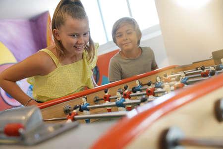 Kids having fun playing foosball