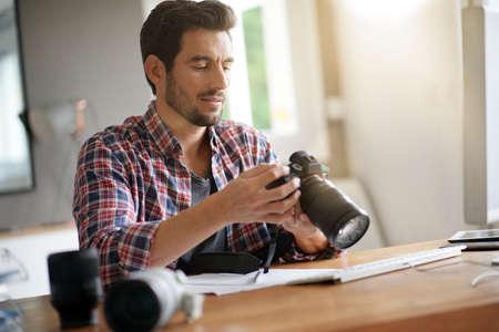 young photographer uploading photos on computer Фото со стока